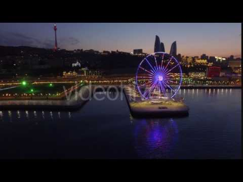 People Rest at an Amusement Park. Ferris Wheel on the Waterfront, Baku City at Night Where One Can