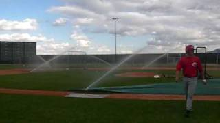 Sprinklers go off during Reds Batting Practice