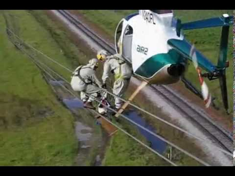 Helicopter Transfering Lineman to Wire