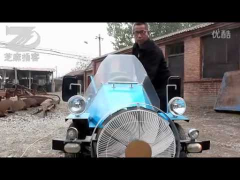 Homemade electric (and wind-powered?) car in rural China