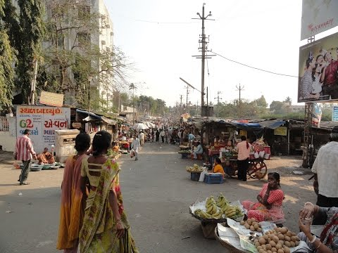 Walking around an Indian Street Market, Dudia Talav fruit & vegetable market, Navsari, India.