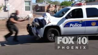 Suspect leaps from roof, runs into policecar