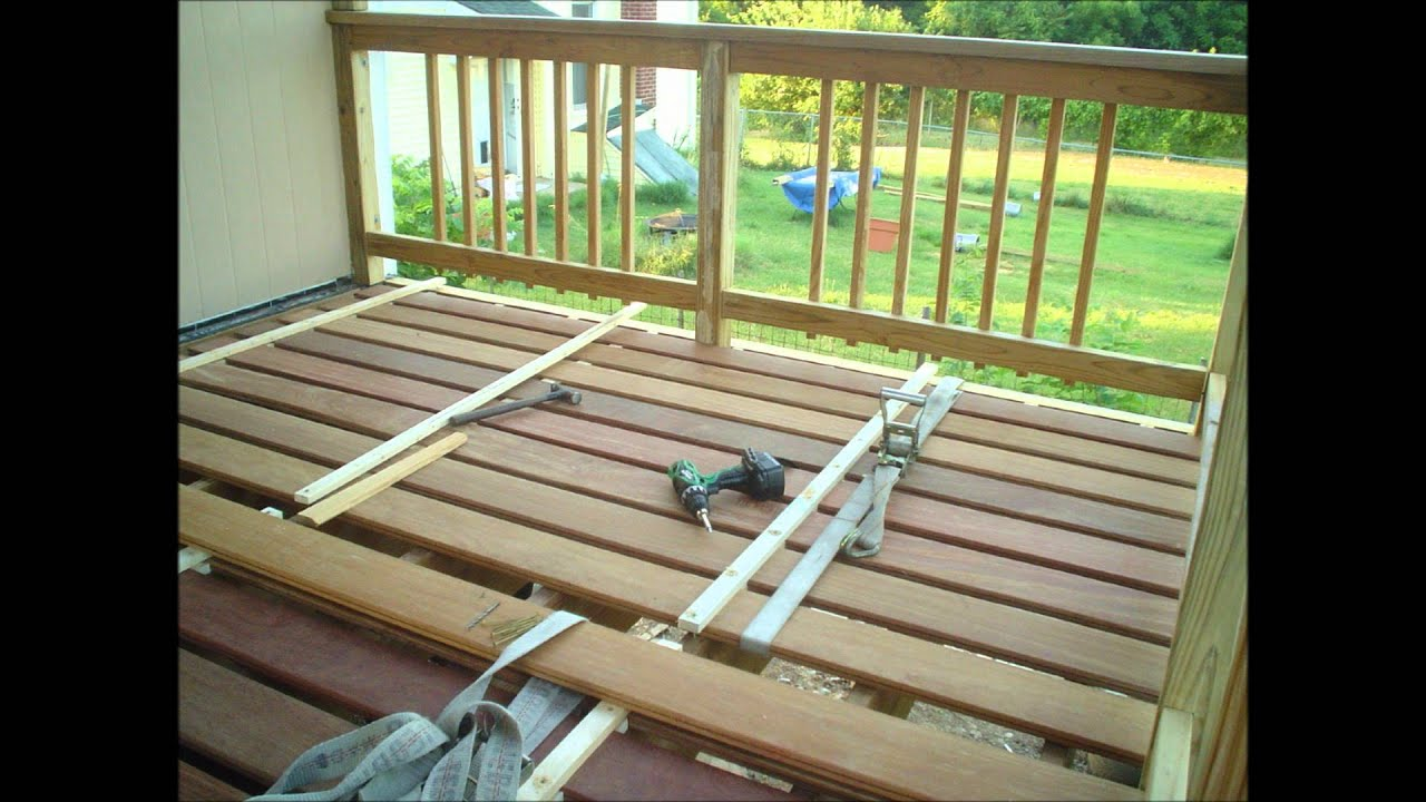 Cumaru deck board clamping idea during acclimation to reduce or