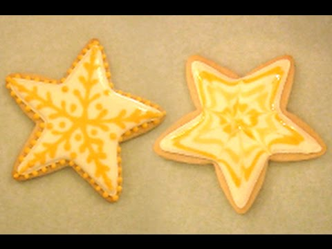 2 Yellow Star Designs With Royal Icing On A Sugar Cookie