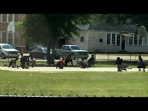 Teens Stop Pickup Basketball Game to Kneel for Passing Funeral Procession
