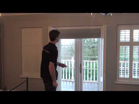 Blackout Plantation Shutters on French Doors in a bedroom