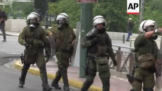 Greek riot police clash with protesting youths