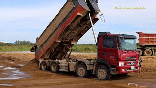 ឡានយីឌុបចាក់ខ្សាច់ Hyundai Dump trucks unloading sand with Bulldozer and Roller