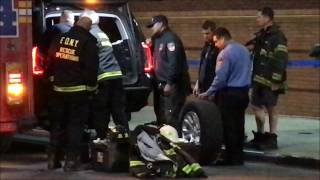 FDNY RESCUE 4, HELPING OUT FDNY CHIEF OF THE DEPARTMENT LEONARD, BY CHANGING HIS FLAT TIRE.