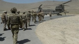 Did U.S. troops die in a chopper crash or enemy gunfire?