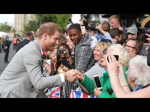 Prince Harry greets crowds outside Windsor Castle