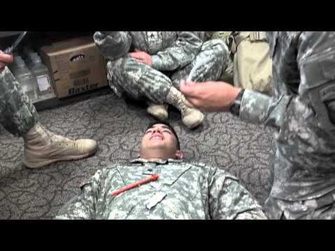 Soldier Takes Breathing Tube In Nose