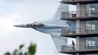 Crazy fighter jet pilot low pass between Australian city buildings