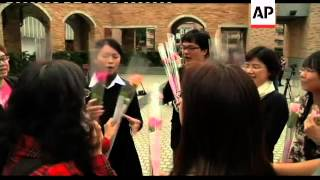 Thai pairs try longest kiss, Taiwan tower proposal, China free meal