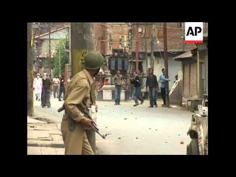 Violent protest in Kashmir, stone throwing, tear gas