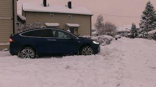 Driving Tesla Model X through deep snow