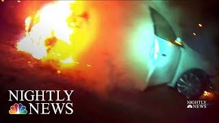 Officers Rescue Unconscious Woman From Burning Vehicle In Dramatic Video | NBC Nightly News