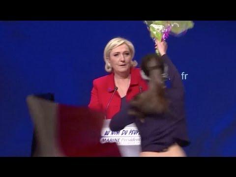 Femen et fumigènes: le meeting perturbé de Marine Le Pen