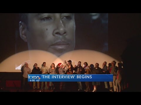 Fans sing God Bless the U.S.A. before first screening of 'The Interview'
