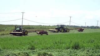 Big tractors mowing