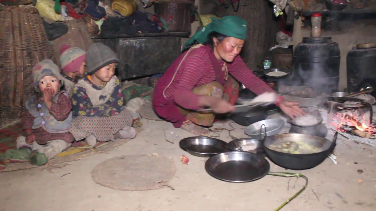 They cook food by using traditional technology and serve to their family