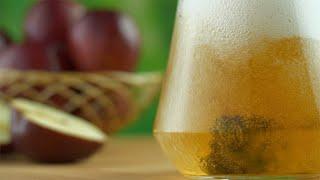 Closeup shot of apple juice poured into a transparent glass jug - healthy diet concept
