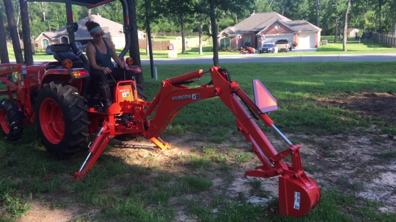Rachels first time using the Kubota BH77 Backhoe