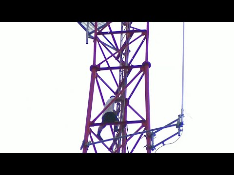 First responders work to talk man down from WKMG TV tower