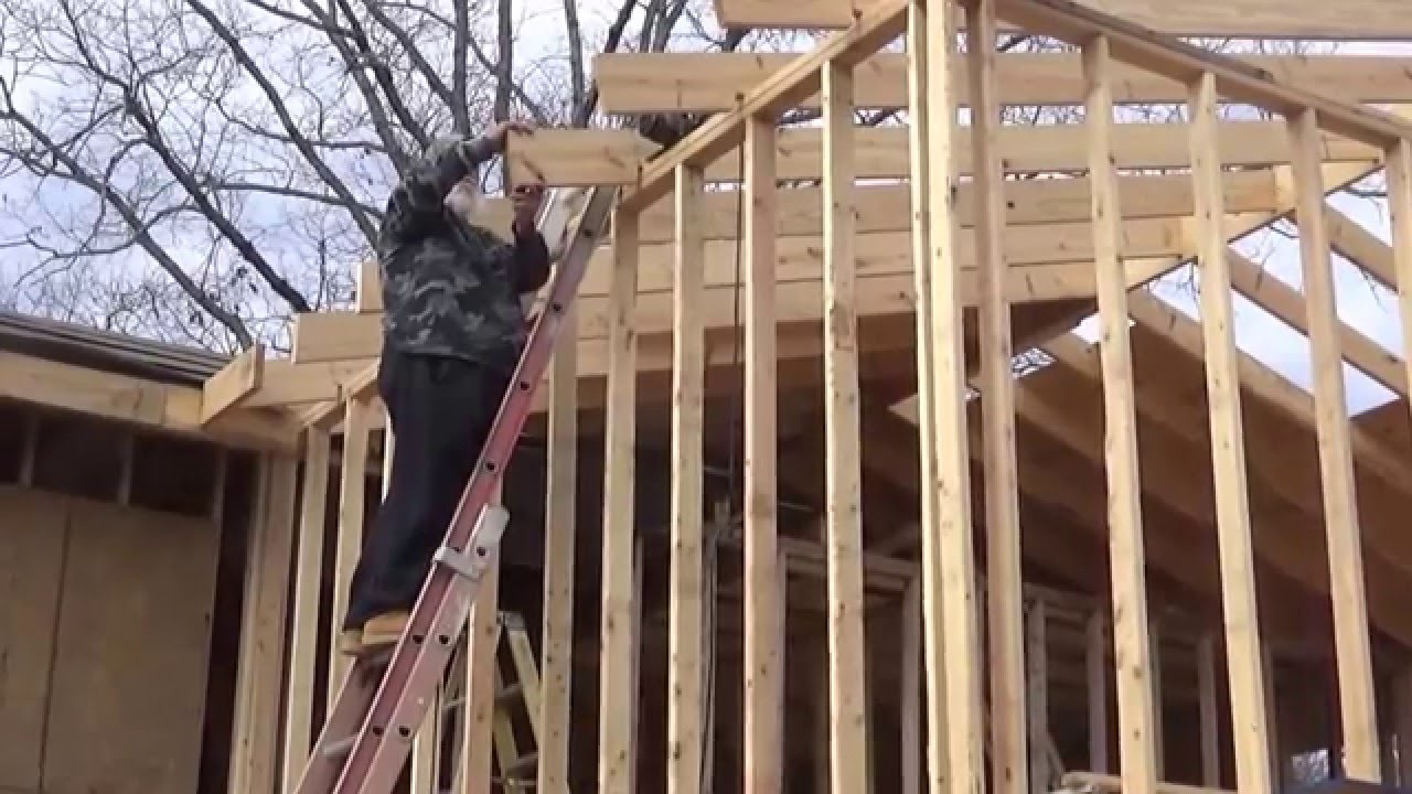 Cutting The Rafter Tails For The Fascia On The Homestead