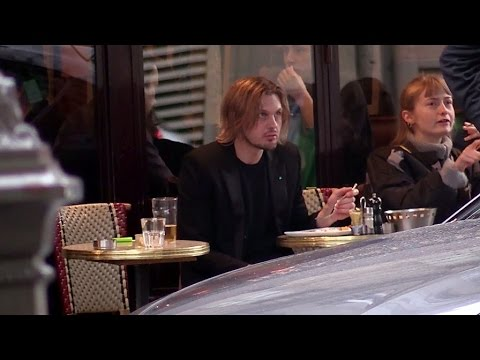 EXCLUSIVE: Michael Pitt having a drink on terrace with his massive Doberman dog in Paris