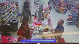 Raw Video: Store shooting, robbery caught on surveillance camera