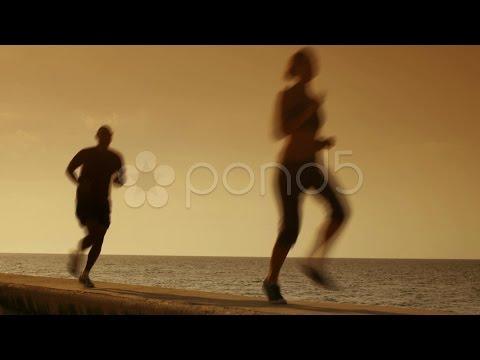 People Doing Sport Activities Near The Sea. Stock Footage