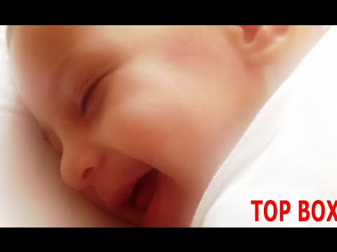 Cute Baby Smiling While Sleeping !