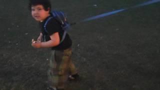 Cute fat kid on leash @ coachella 09
