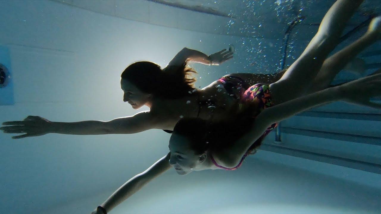Carla underwater swimming at sunset and night