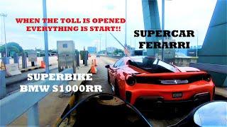 supercar ferrari vs superbike.. sound echoed along the highway.. Ferrari driver really 👍👍