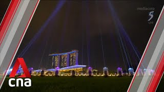 Singapore welcomes 2021 with light show at Marina Bay and fireworks in the heartlands