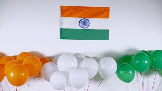 Closeup of Indian tricolor flag and colorful balloons - 26 January/15 August, festive scene
