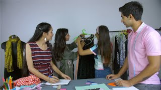 Young students taking a fashion designing class from a professional designer