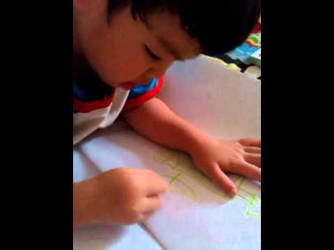 เด็กน้อยวาดรูปรถไฟ
