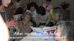 Caregivers reading with Two-Lap Books Alzheimer's patients