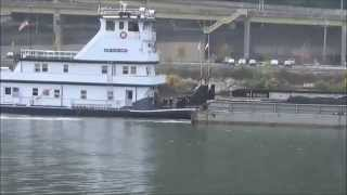 A Loaded Coal Barge Heads Down The Allegheny River In Pittsburgh, PA