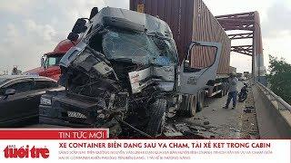Xe container biến dạng sau va chạm, tài xế kẹt trong cabin