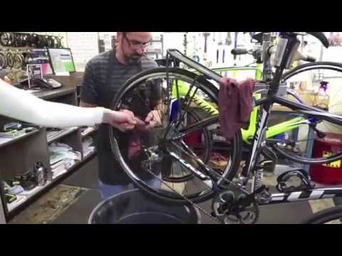 Cleaning the drivetrain and chain of a bike.