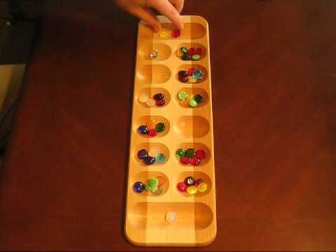 Mancala The African Stone Game YouTube Beauteous Game With Stones And Wooden Board