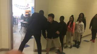 Teacher creates personalized handshakes for all his students