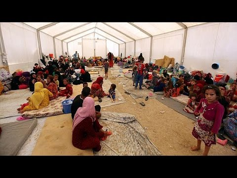 In northern Iraq, thousands flee Mosul campaign