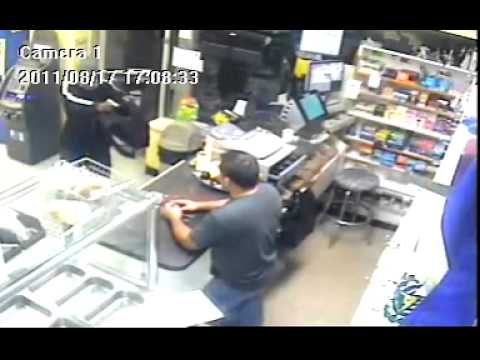 Robber with gun sticks-up bodega, employee fights off robber with machete