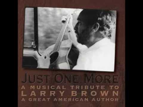 Larry Brown sings three songs