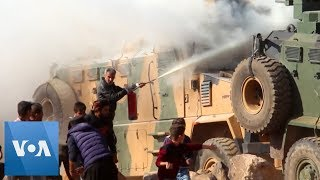 Syria Protesters Hurl Rocks at Joint Turkey-Russia Patrol Near Kobane